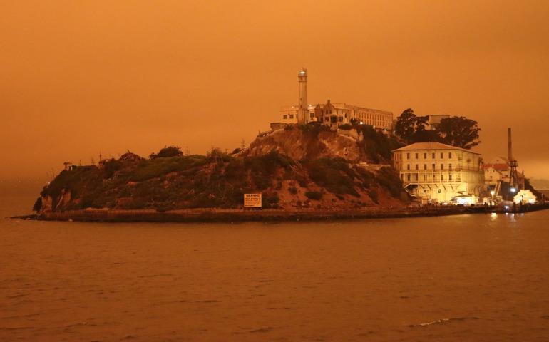 orange sky view of alcatraz island