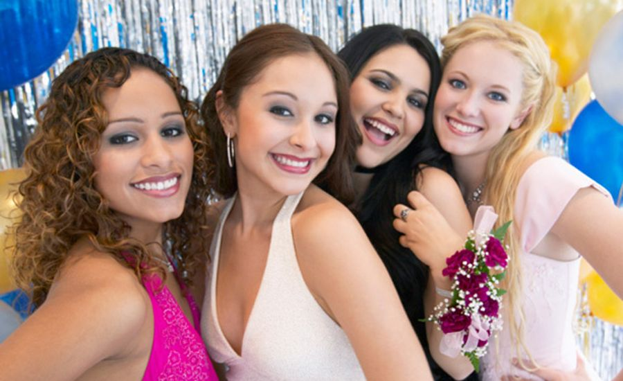 Group of girls posing for high school prom.