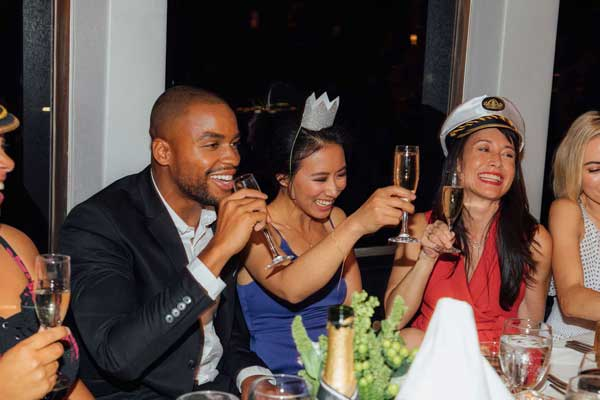 People celebrating on a boat drinking champagne