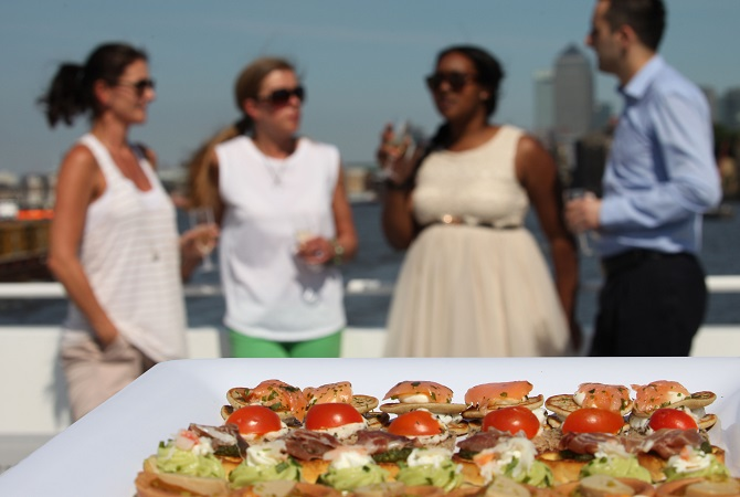 Plate of food people in background on boat