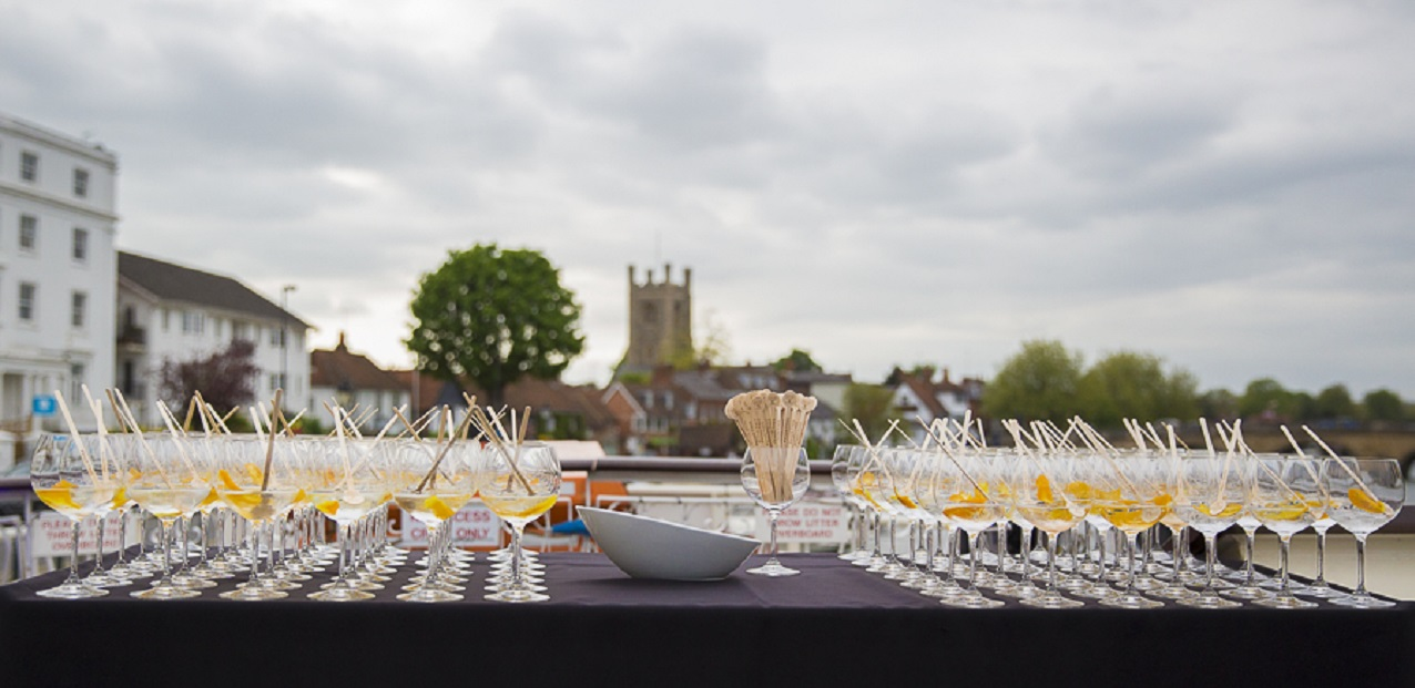 Rows of glasses on table with city in background