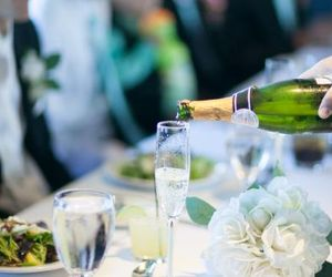 Champagne being poured into glass on table