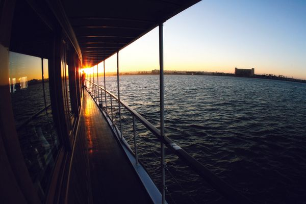 Outside boat walkway and railing at sunset