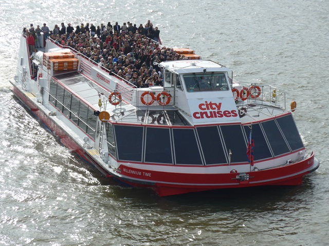 City Cruises boat with people on top deck.
